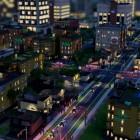 Vue nocturne d'une ville simulée par SimCity.
