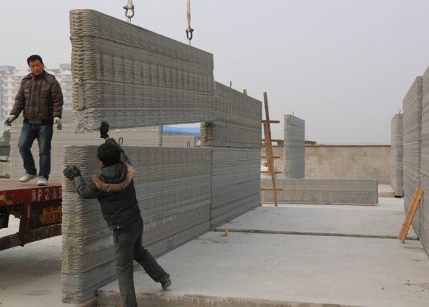 Assemblage des murs imprimés en 3D / © Yingchuang New Materials
